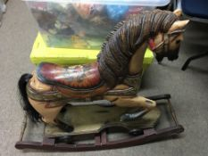 A reproduction Victorian style rocking horse.