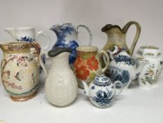 A collection of large jugs and a Worcester style t