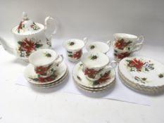 A Royal Albert bone china Ponsettia pattern six pl
