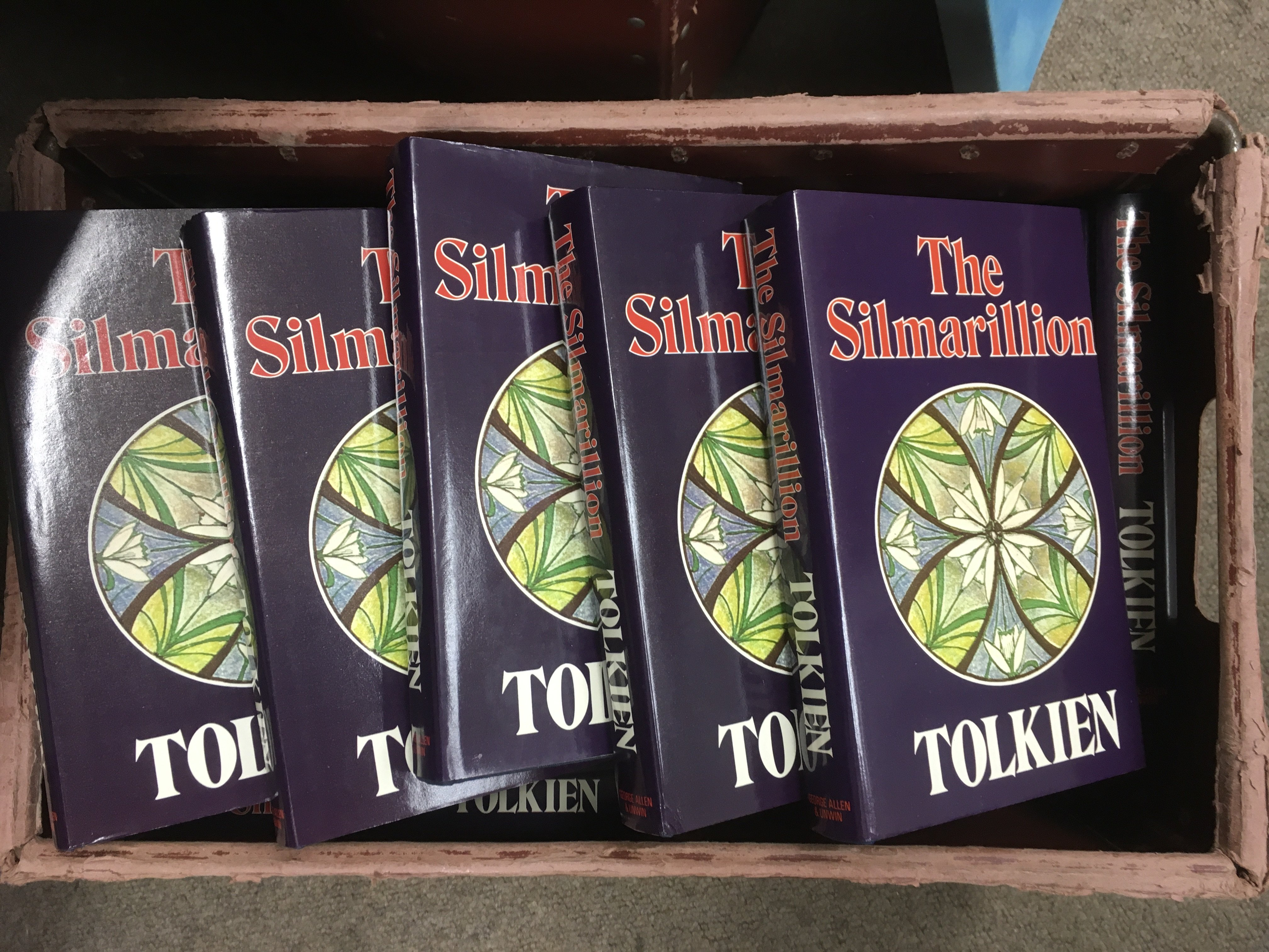 A box containing a collection of 14 first edition