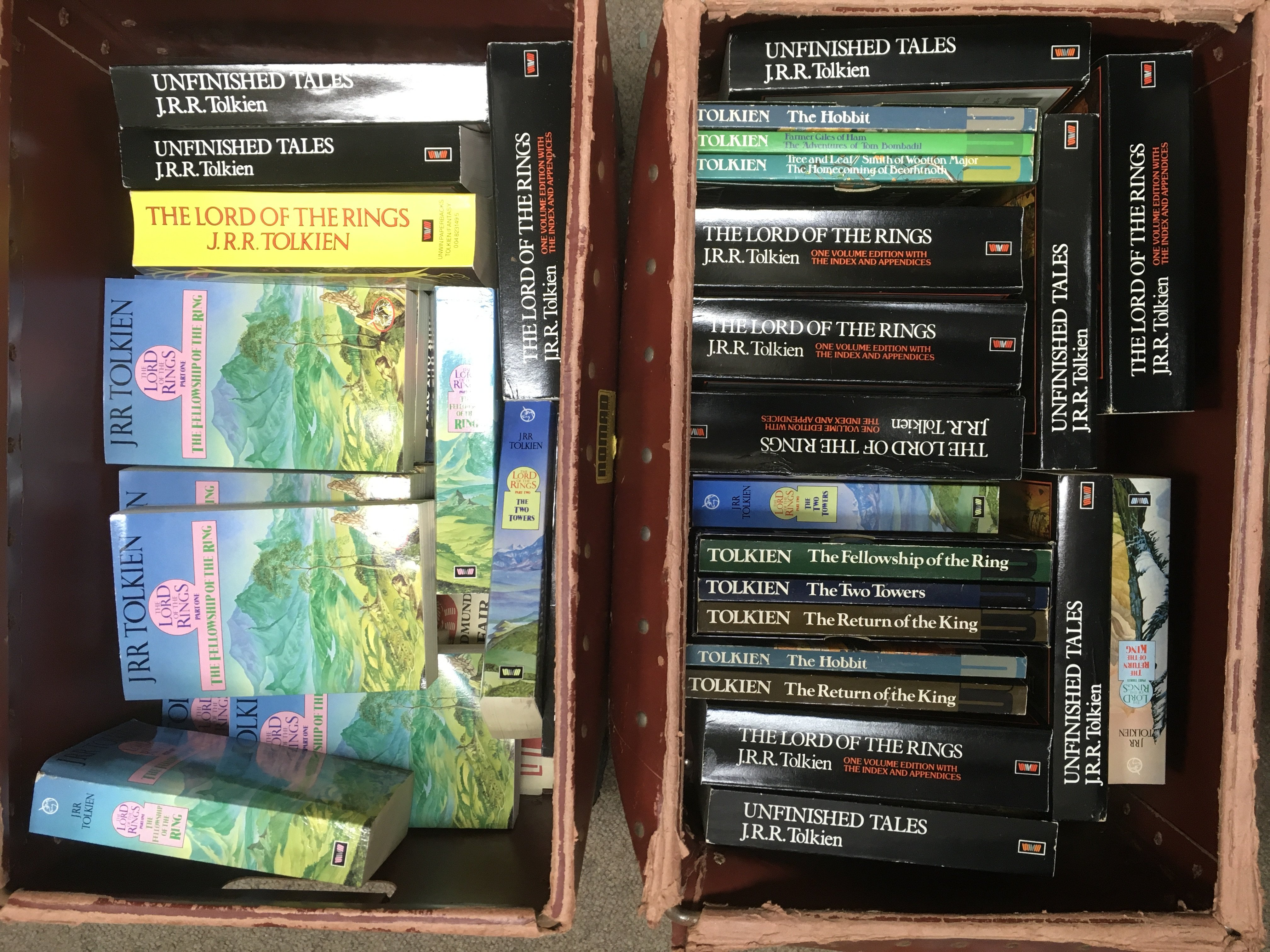Two boxes of JRR Tolkien paperback books.