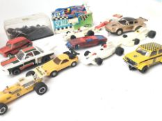 A Box Containing a Collection of Scalextric Cars in Various States./spares. Bridges. And box of