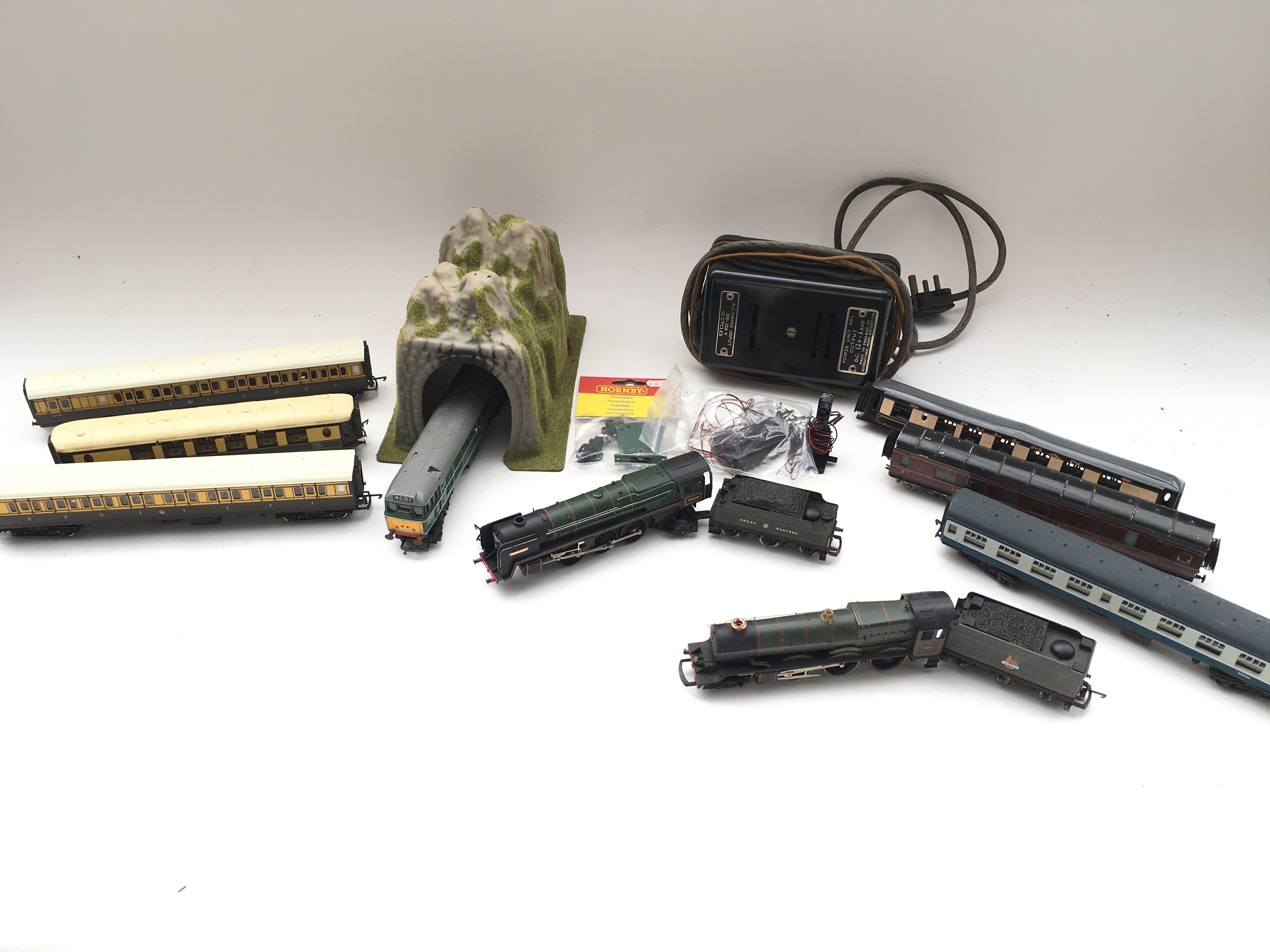 Collection of trains - coaches - controller - colour light signal and switch.