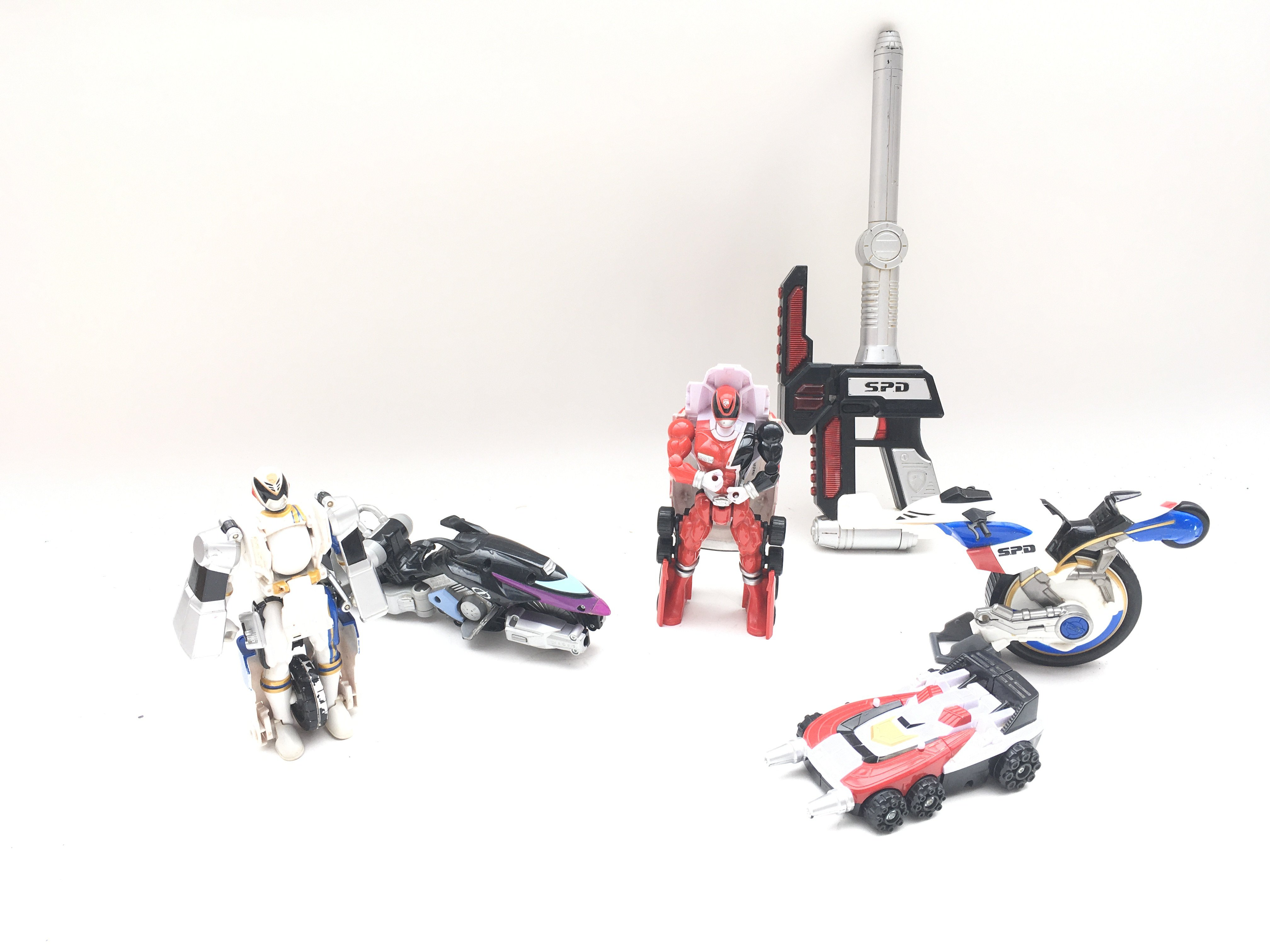 Collection of playworn power rangers SPD figures and vehicles.
