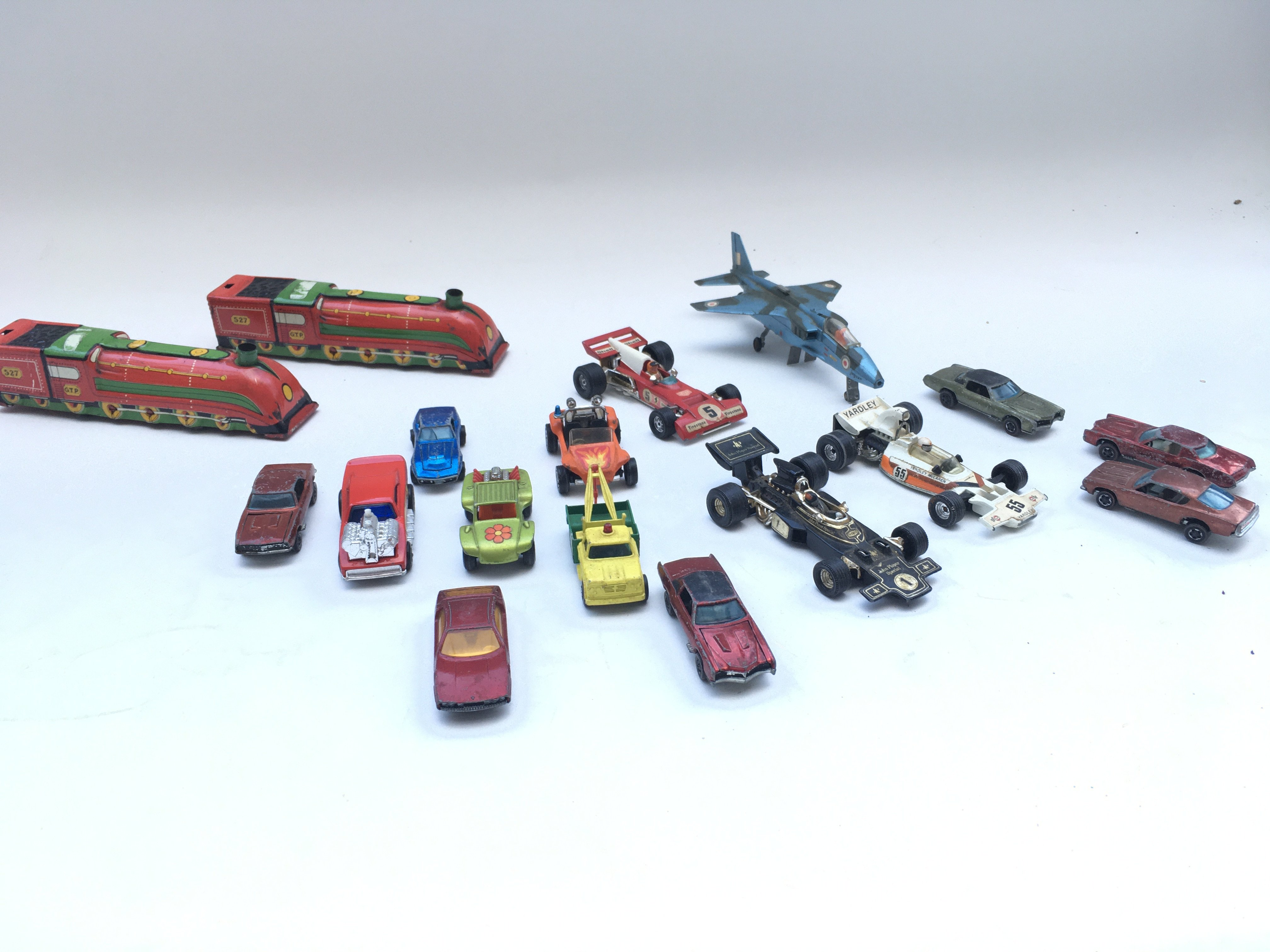 Pair of tin trains. Collection of cars including Corgi and hot wheels.