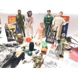 A Large Collection of Action Man Including 5 Figur