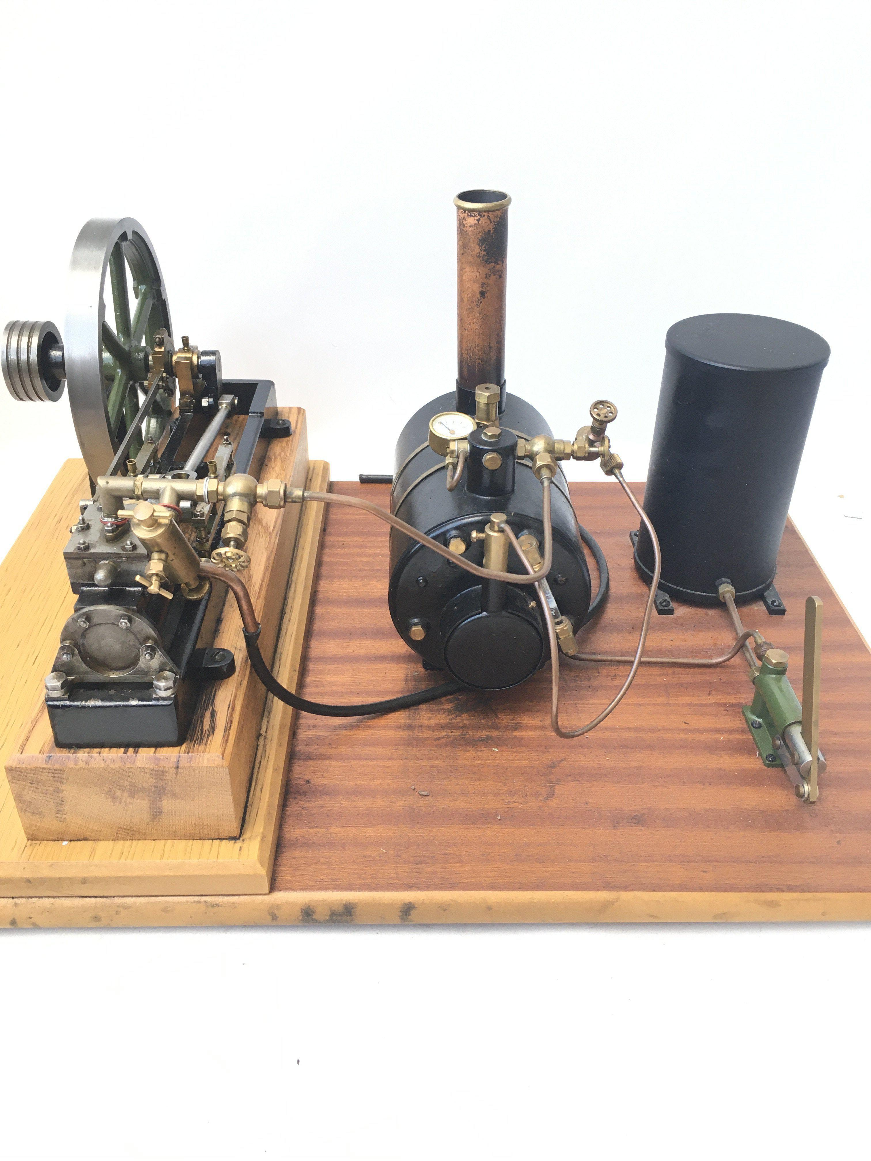 A Stuart Models Steam Engine including Feed Pump & Reservoir. Includes oils and certificate of