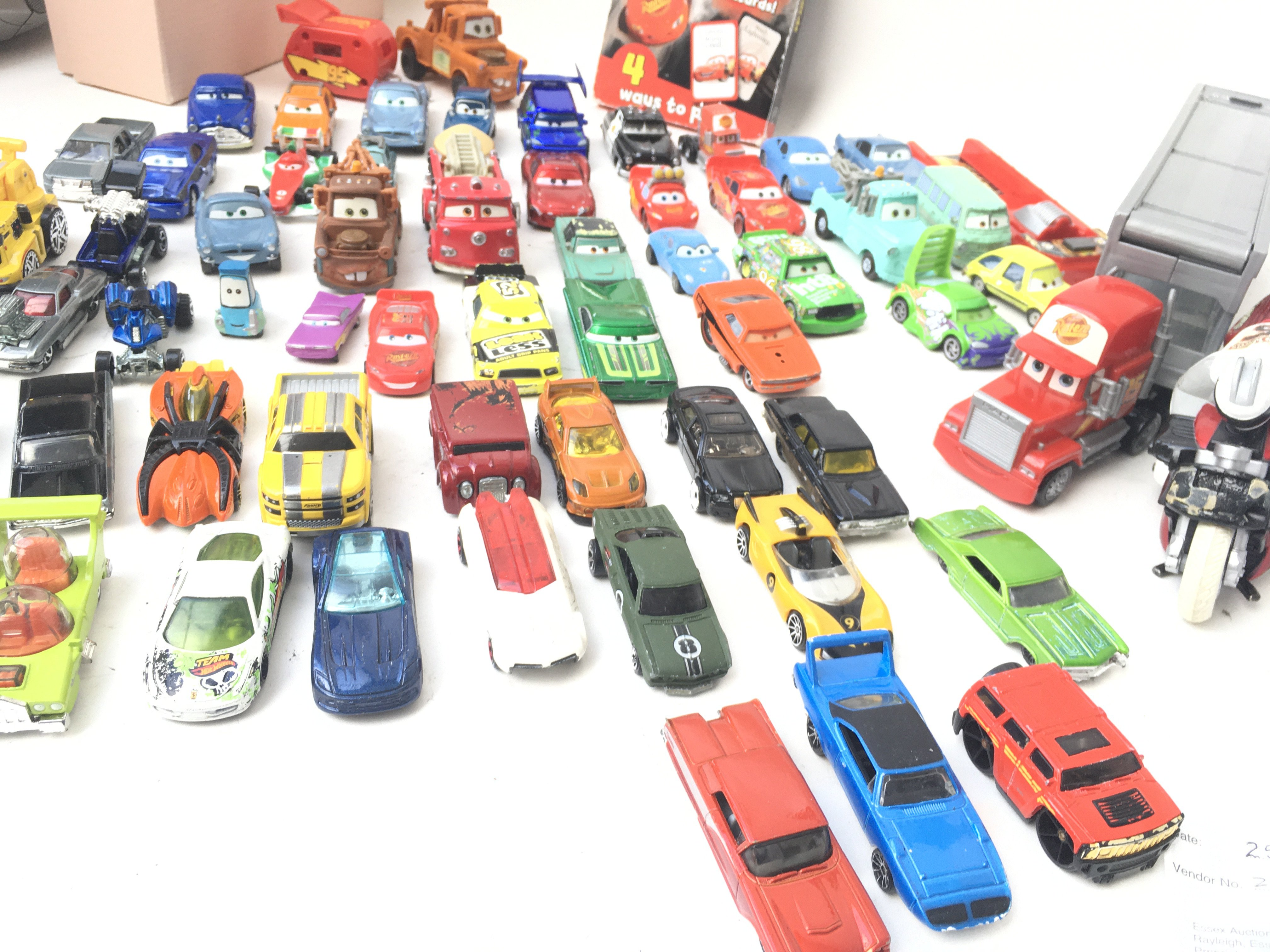 A Collection of Disney Cars and Hotwheels.