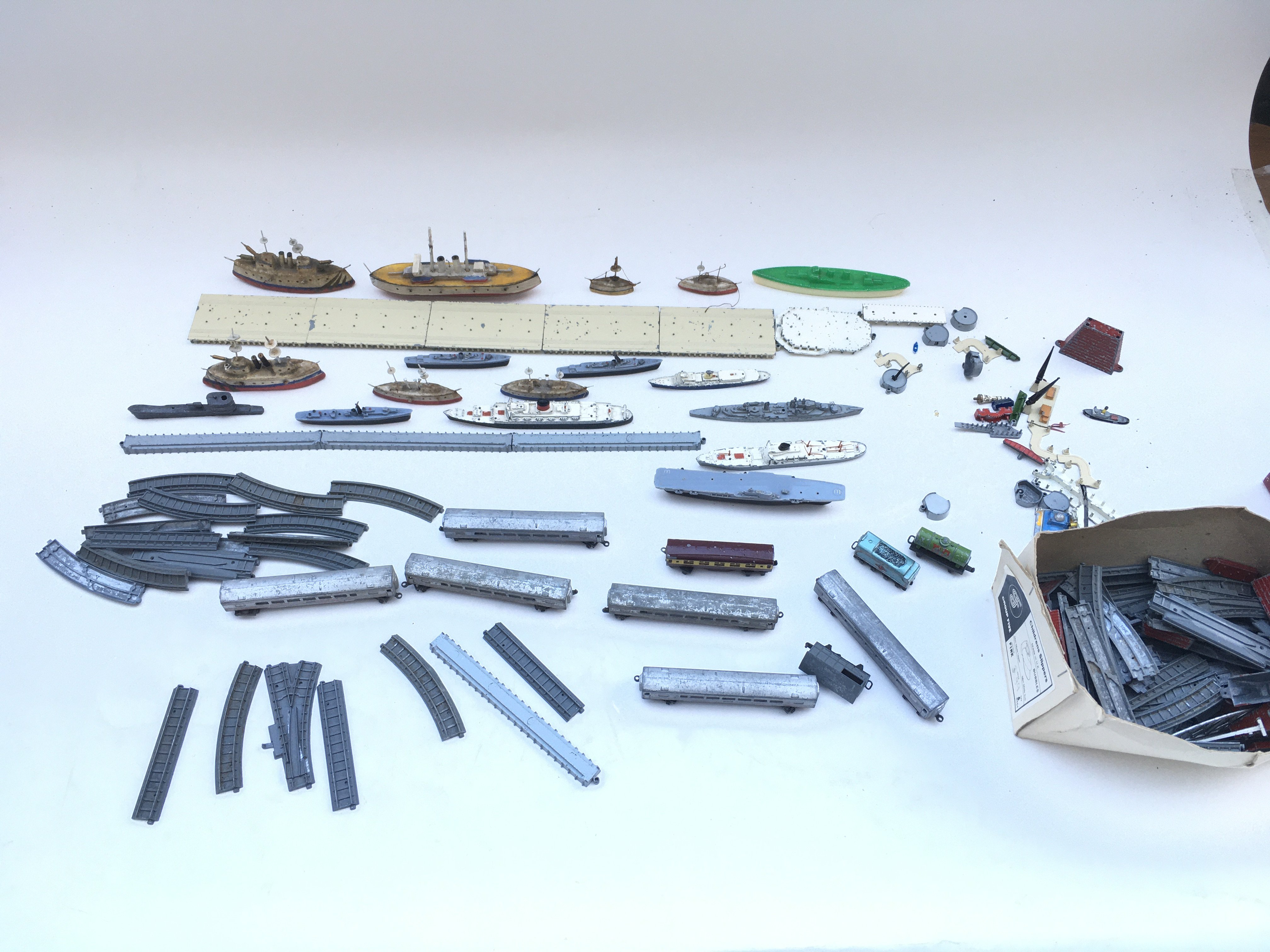 Large collection of playworn toys including lone star locco- Triang ships.