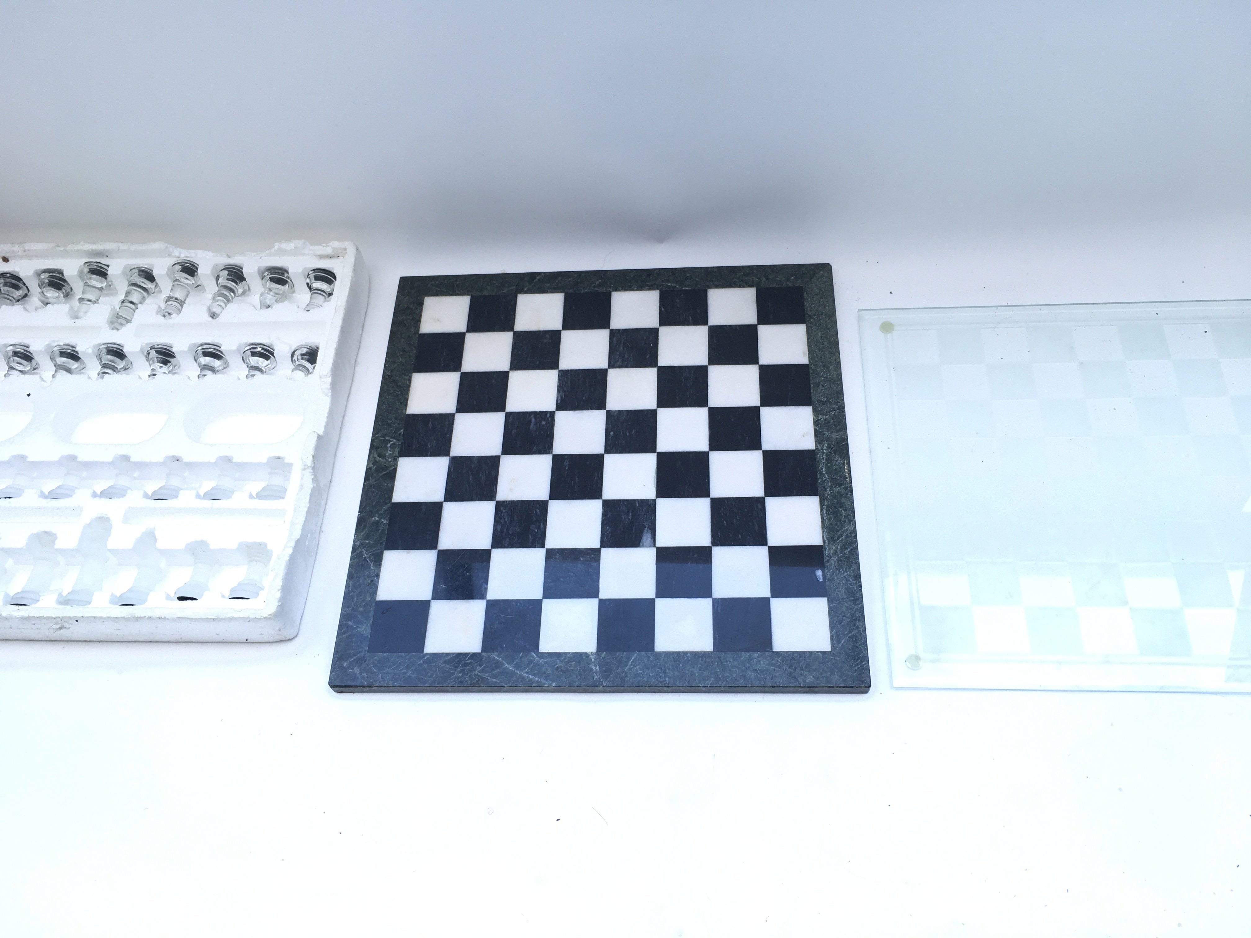 Chess set with two boards. One glass and one stone.