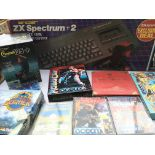 A Boxed ZX Spectrum +2 with games and Joystick.(2)
