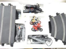 A Boxed Scalextric Moto GP World Championship set.