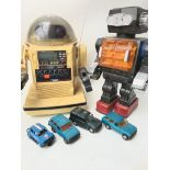 A Bag contains 2 X Robots. A Scalextric car and 3x Die-cast Vehicles.
