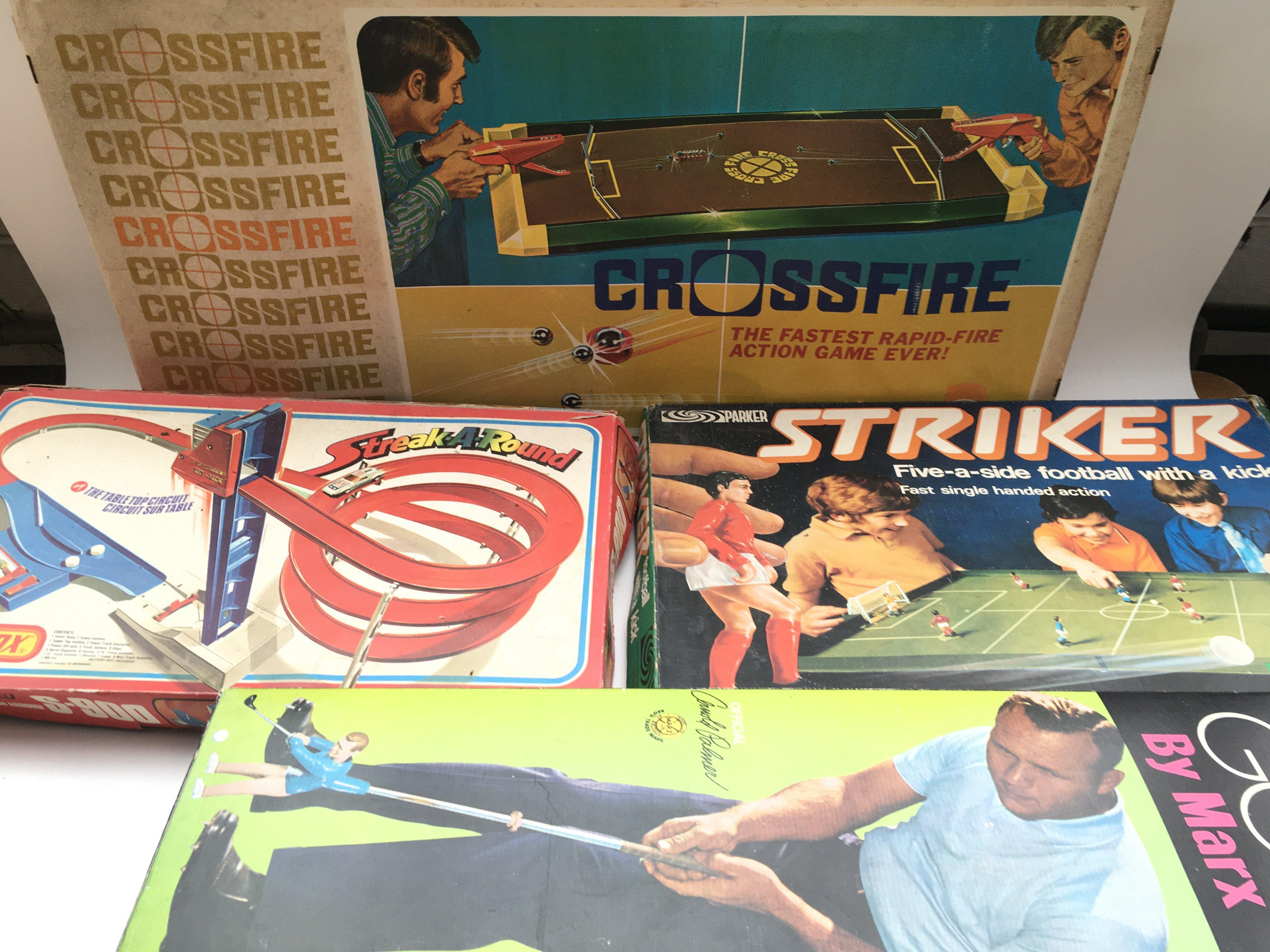 Collection of games including Matchbox. Striker. Arnold Palmer pro golf shot. Crossfire.