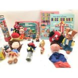 A Collection of Magic Roundabout toys and books. I
