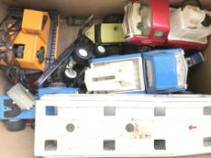 A box containing Playworn Tonka toys and a Fly Lec