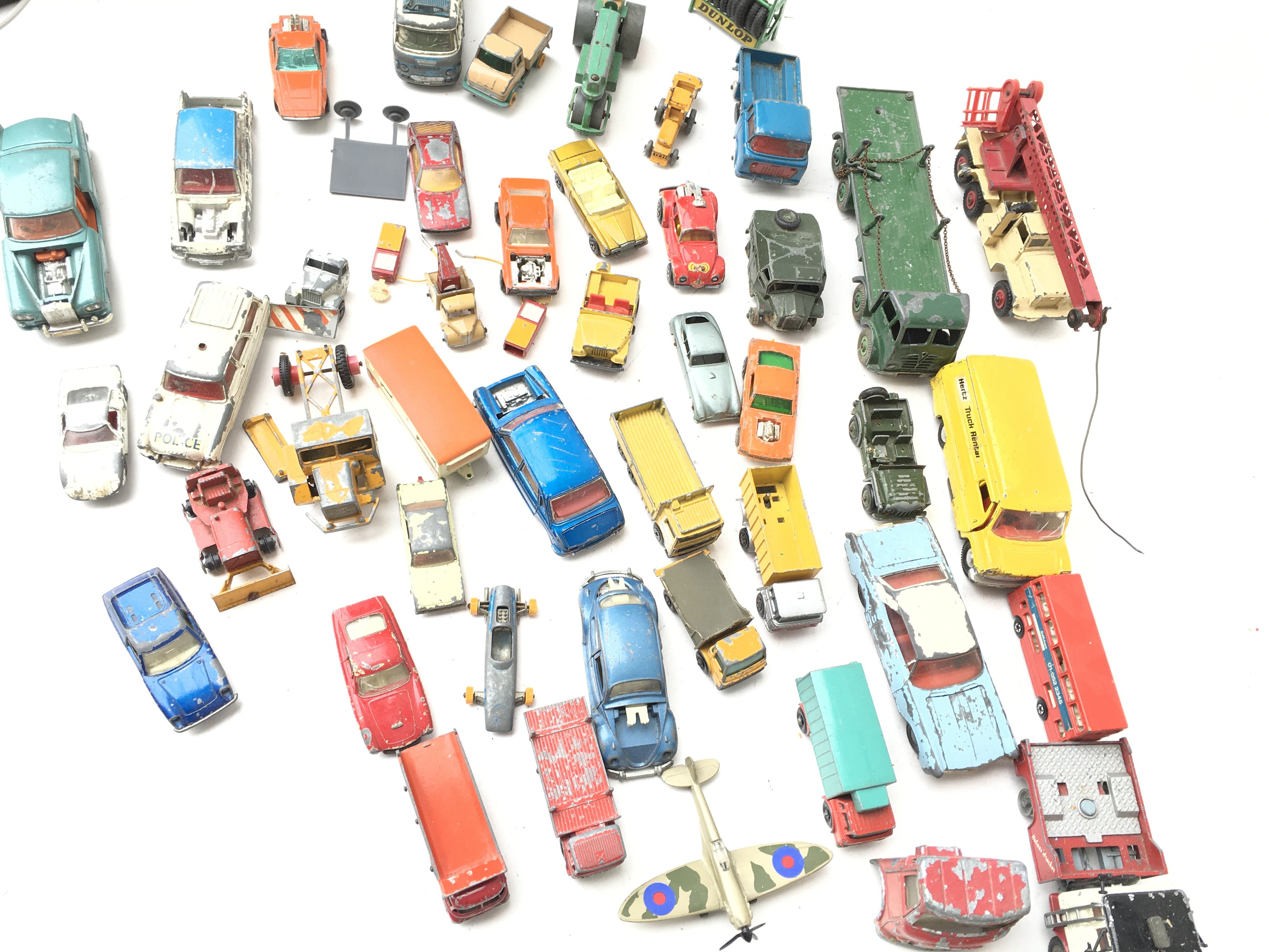 A Box Containing A Collection of Playworn Vehicles