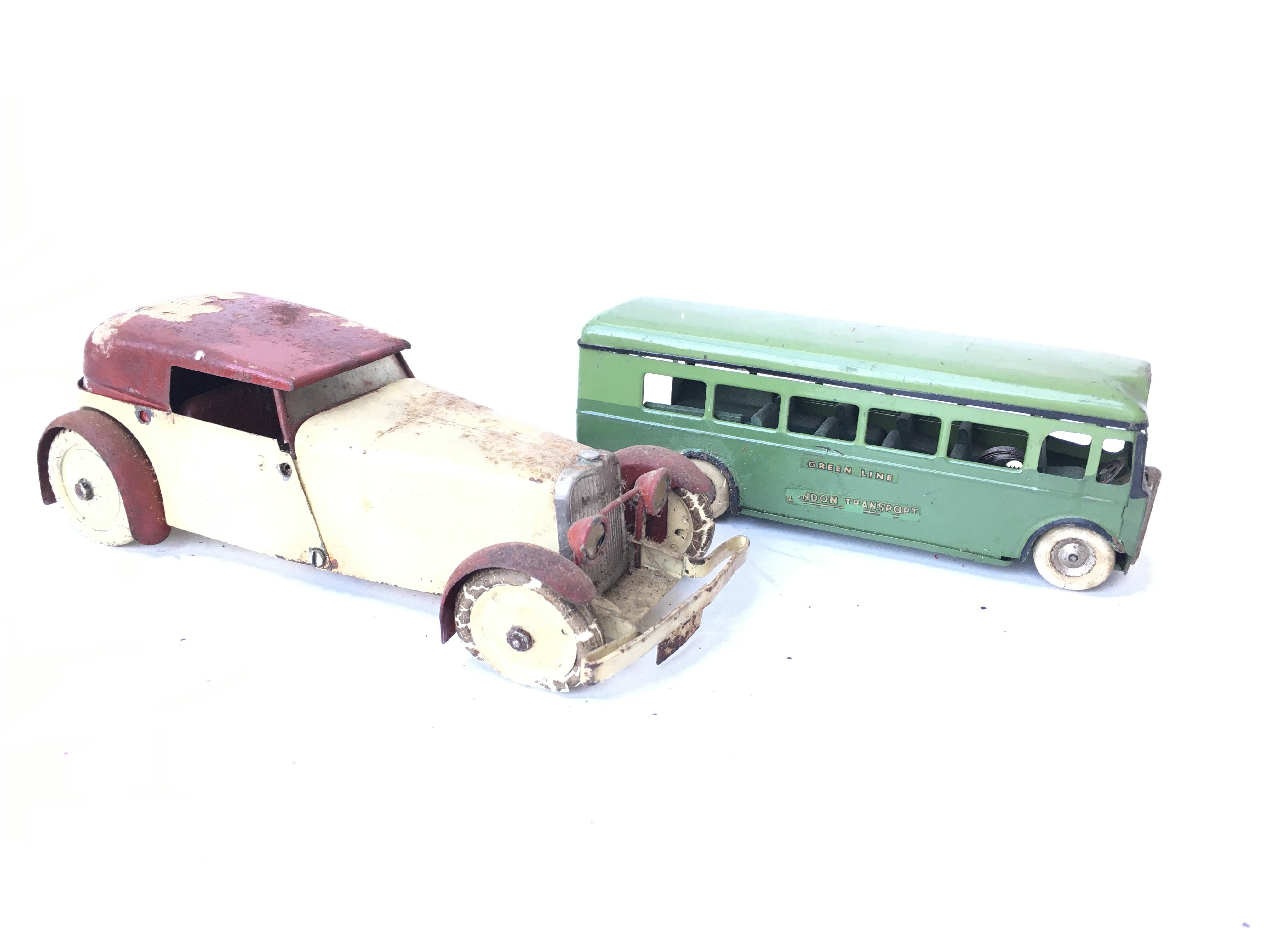 A Tri-Ang Minic Toys Green Line Bus and a Tin Plat