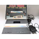 A Boxed Atari 7800 boxed with controllers.
