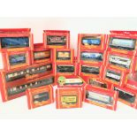 A Box Containing a Collection of Hornby 00 Gauge Rolling Stock and Coaches.