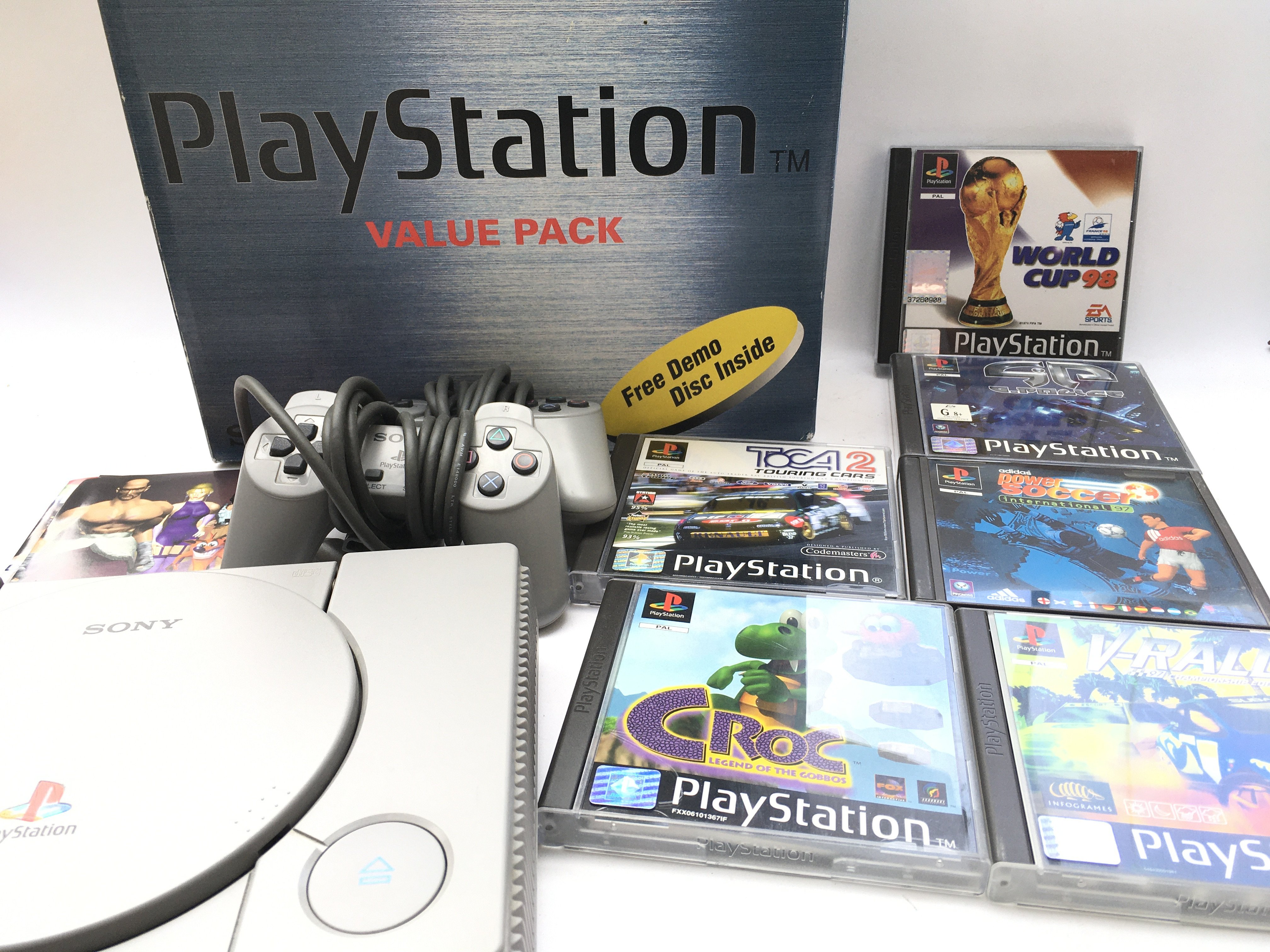 A Boxed PlayStation one With 6 Games. 2 Controller
