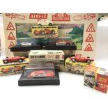 A Box Containing A Collection Of Airfix Slot Racin
