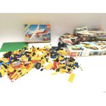 A collection of loose Lego. Legoland 6375 - boxed. Two empty Lego boxes.