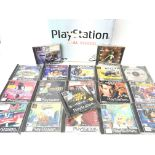A Boxed PlayStation 1 with Games.
