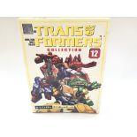 A Boxed Takara Transformers #12 Minibot.