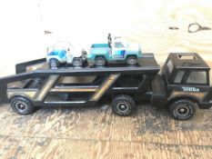 A Vintage Tonka Car Transporter with Vehicles.