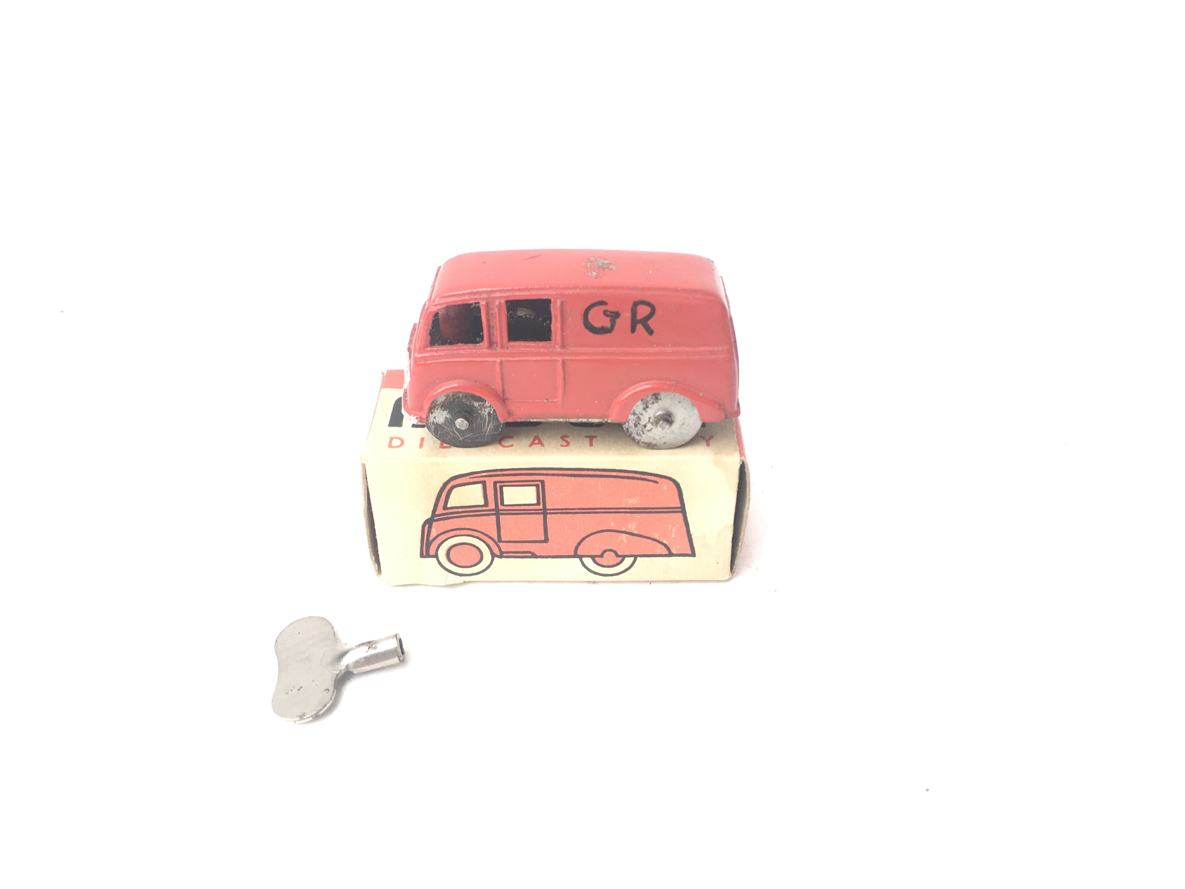 A Boxed Chad Valley Midget Van. With Key.