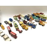 A Box Containing a Collection of Playworn Die Cast