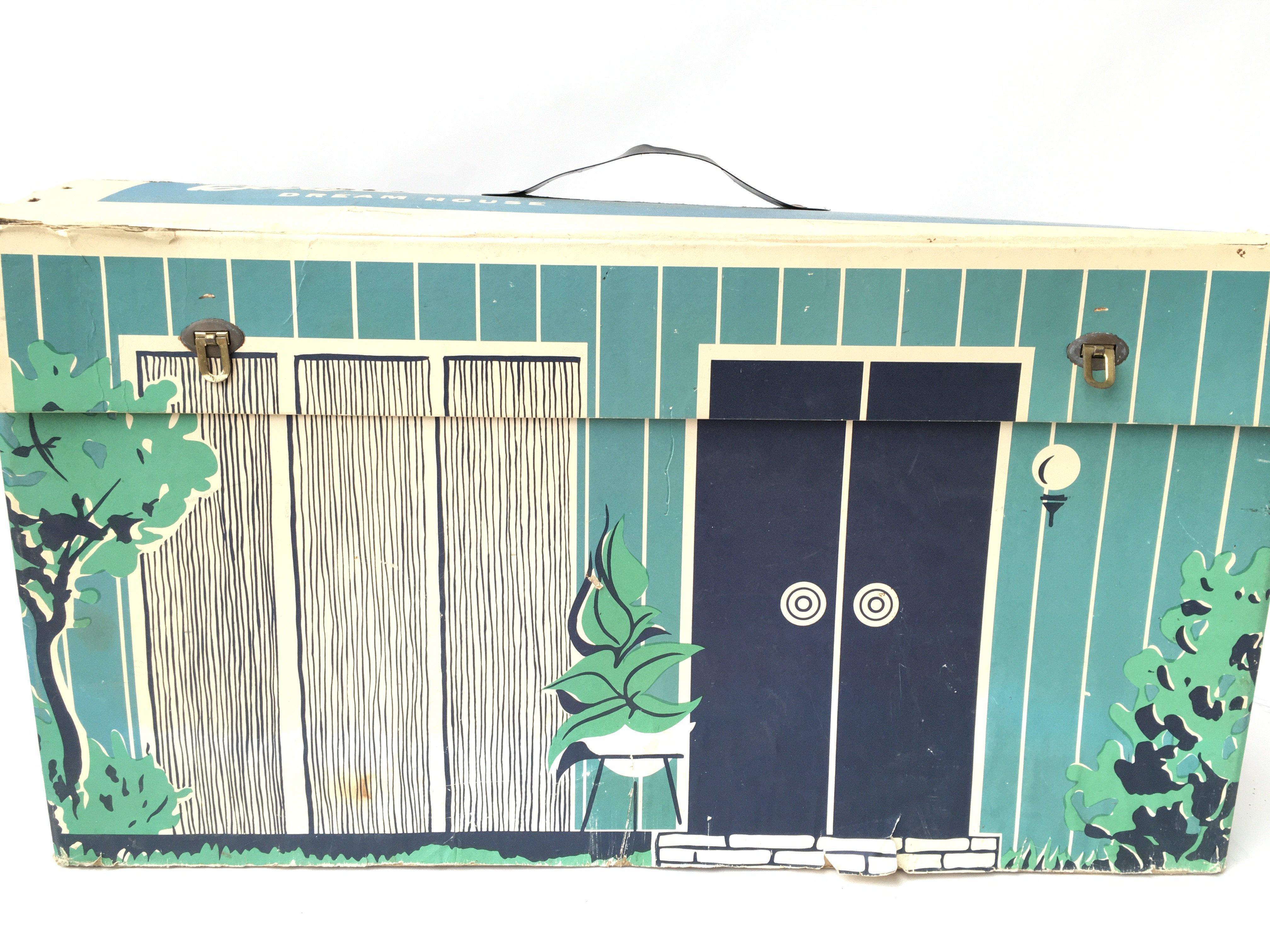 A vintage Boxed Barbie Dream House.