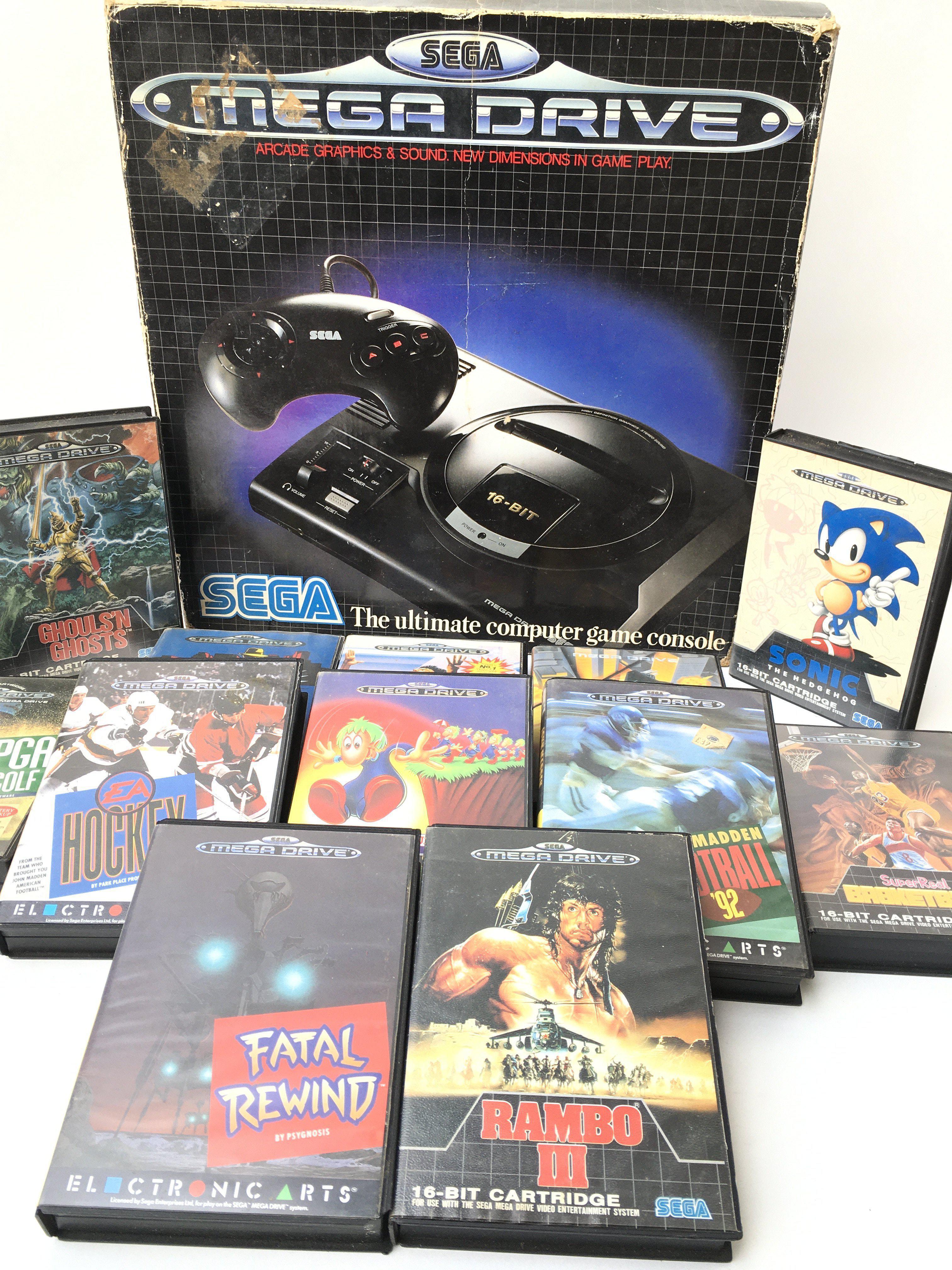 A Boxed Sega Mega Drive with games.