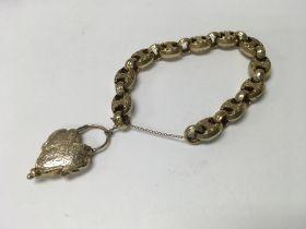 A Victorian link bracelet with heart shape mournin
