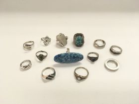 Thirteen silver rings, some set with semi precious