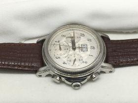 A cased Phillipe Dubois Grande Date watch.