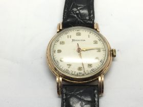 A 9ct gold cased Helvetia watch.