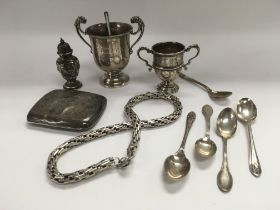 A collection of silver cups and other silver items