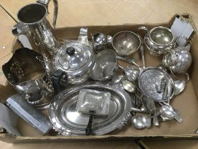 A box of silver plated items.
