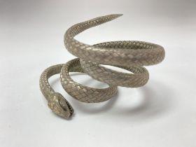 An unusual white woven metal snake bangle.