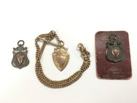 A gold watch chain and fob together with two silver watch fobs (3).