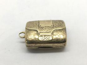 A Georgian silver gilt vinaigrette in the form of