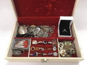 A jewellery box of silver and other jewellery item