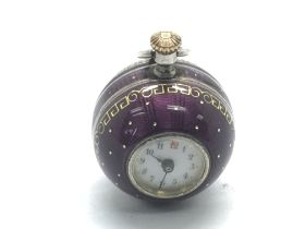 A 1920s silver and purple enamel ball shaped fob w