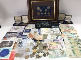A collection of coins and bank notes including pro