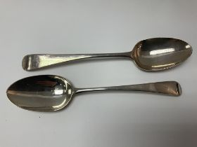 A pair of Georgian silver serving spoons.