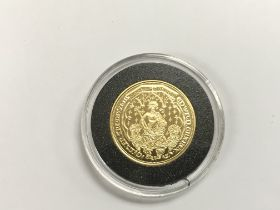 A gold proof double leopard coin from the Millionaires collection with COA.