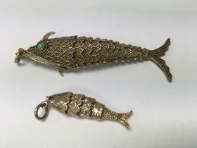 A small 9 ct articulated fish 7 grams and one othe