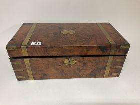 A Victorian walnut veneered brass bound writing sl